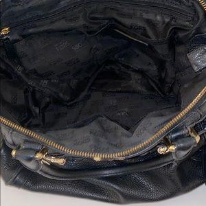 Michael kors.  Black bag with strap  satchel style